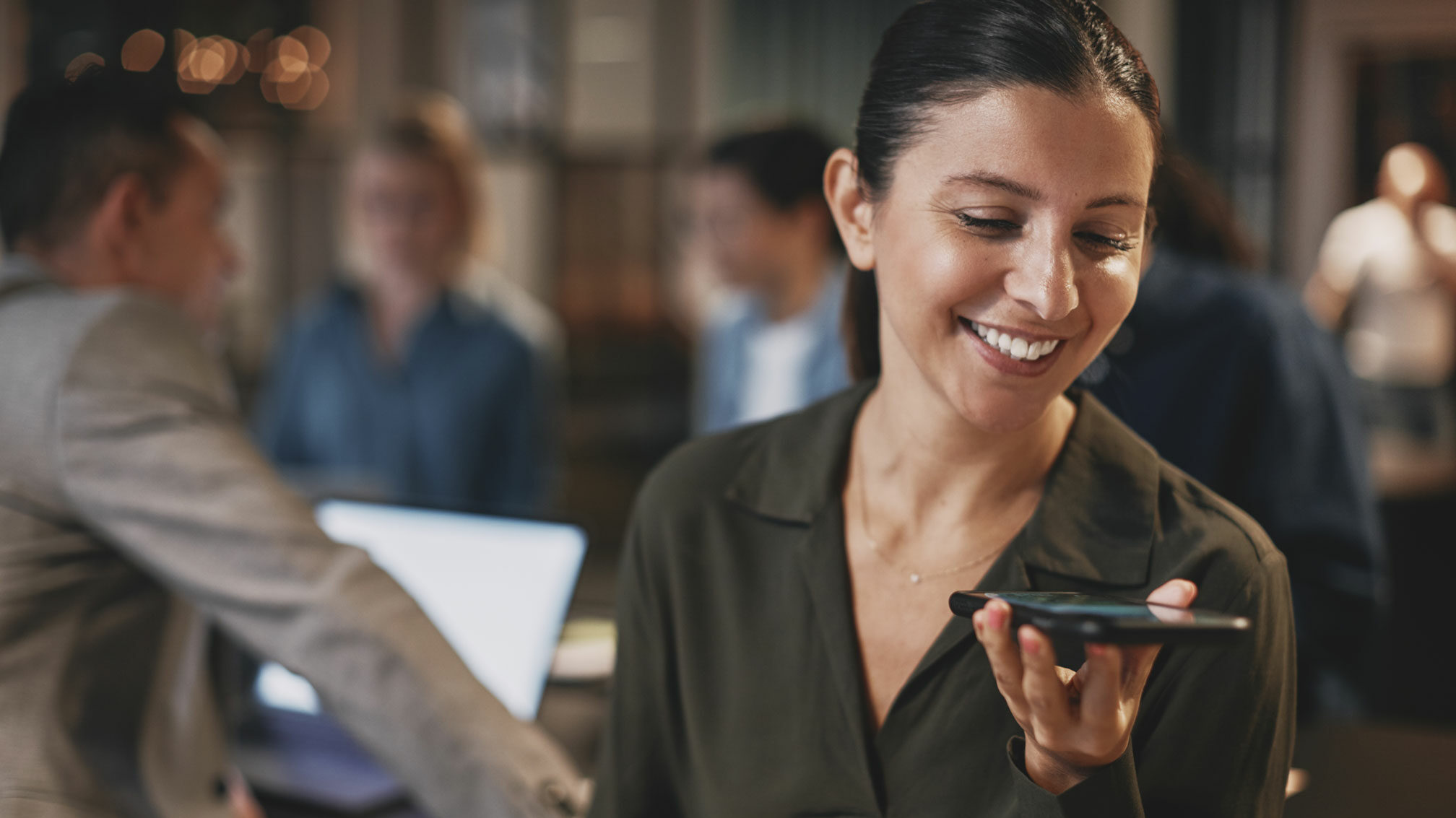 Woman talking to customer support on phone